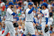 (L-R) Brandon Morrow #15 of the Chicago Cubs, Anthony Rizzo #44, and David Bote #13, celebrate their win against the Minnesota Twins at Wrigley Field on July 1, 2018 in Chicago, Illinois. The Chicago Cubs won 11-10.
