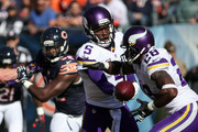 Quarterback Teddy Bridgewater #5 hands the football off to Adrian Peterson #28 of the Minnesota Vikings in the second quarter against the Chicago Bears at Soldier Field on November 1, 2015 in Chicago, Illinois.