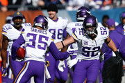 Marcus Sherels #35 of the Minnesota Vikings celebrates with  Chad Greenway #52 after scoring a touchdown on a 65 yard punt return against the Chicago Bears in the first quarter at Soldier Field on November 1, 2015 in Chicago, Illinois.