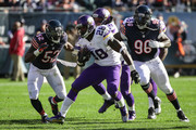 Adrian Peterson #28 of the Minnesota Vikings carries the football against  LaRoy Reynolds #52 and  Jarvis Jenkins #96 of the Chicago Bears in the second quarter at Soldier Field on November 1, 2015 in Chicago, Illinois.