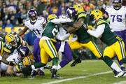 Adrian Peterson #28 of the Minnesota Vikings scores a touchdown during the third quarter against the Green Bay Packers at Lambeau Field on January 3, 2016 in Green Bay, Wisconsin.