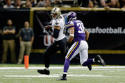 Jimmy Graham #80 of the New Orleans Saints catches a pass in front of Robert Blanton #36 of the Minnesota Vikings during the first quarter of a game at the Mercedes-Benz Superdome on September 21, 2014 in New Orleans, Louisiana.