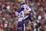 Cornerback Mackensie Alexander #20 of the Minnesota Vikings celebrates with free safety Harrison Smith #22 of the Minnesota Vikings after an interception during the second quarter against the Washington Redskins at FedExField on November 12, 2017 in Landover, Maryland.