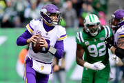 Kirk Cousins #8 of the Minnesota Vikings looks to pass against the New York Jets during the second quarter at MetLife Stadium on October 21, 2018 in East Rutherford, New Jersey.