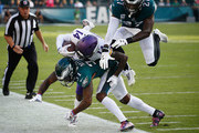 Wide receiver Stefon Diggs #14 of the Minnesota Vikings is tackled by cornerback Jalen Mills #31 and strong safety Malcolm Jenkins #27 of the Philadelphia Eagles during the first quarter at Lincoln Financial Field on October 7, 2018 in Philadelphia, Pennsylvania.