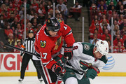 Sheldon Brookbank #17 of the Chicago Blackhawks battles for the puck with Cody McCormick #8 of the Minnesota Wild in Game Five of the Second Round of the 2014 NHL Stanley Cup Playoffs at the United Center on May 11, 2014  in Chicago, Illinois.  The Blackhawks defeated the Wild 2-1.