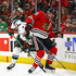 Jonathan Toews Photos - Eric Staal #12 of the Minnesota Wild and Jonathan Toews #19 of the Chicago Blackhawks battle for the puck at the United Center on December 17, 2017 in Chicago, Illinois. - Minnesota Wild v Chicago Blackhawks