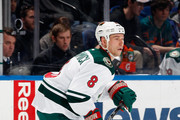 Cody McCormick #8 of the Minnesota Wild skates during an NHL hockey game against the New York Islanders at Nassau Veterans Memorial Coliseum on March 18, 2014 in Uniondale, New York.
