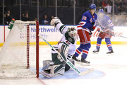 Devan Dubnyk #40 of the Minnesota Wild gives up a goal to Jesper Fast #17 of the New York Rangers in the second period during their game at Madison Square Garden on February 23, 2018 in New York City.