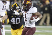 IOWA CITY, IOWA- OCTOBER 28: Running back Rodney Smith #1 of the Minnesota Golden Gophers runs up the field in the second quarter between defensive back Amani Hooker #27 and defensive end Parker Hesse #40 of the Iowa Hawkeyes on October 28, 2017 at Kinnick Stadium in Iowa City, Iowa.