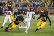 Rodney Smith #1 of the Minnesota Golden Gophers tries to run the ball between Michael Wroblewski #46 and Jordan Glasgow #29 of the Michigan Wolverines during a college football game at Michigan Stadium on November 4, 2017 in Ann Arbor, Michigan.