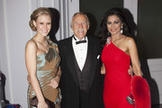 In this handout provided by Miss World Ltd, Sir Bruce Forsyth (C) poses with his wife Wilnelia (R), a former Miss World, and the current Miss World 2010 Alexandria Mills (L) during a Miss World dinner at the Hilton Park Lane, as part of the Miss World 2011 UK Tour, on October 31, 2011 in London, United Kingdom. The tour celebrates Miss World's 60th birthday. The final of the competition will take place in Earls Court, London on Sunday 6th of November. (Photo by Ian Jones /Miss World Ltd via Getty Images)..