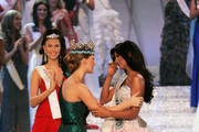Miss Venezuela Ivian Sarcos receives her Miss World 2012 sash from Miss World 2011 by Miss World 2010, Alexandria Mills (R) in the Miss world 2011 World Final on November 6, 2011 in London, England.