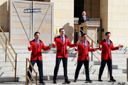 """(L-R) Travis Cloer, Rob Marnelle, Deven May and Jeff Leibow of """"The Jersey Boys"""" perform at the grand opening of The Mob Museum as the museum's executive director Jonathan Ullman looks on February 14, 2012 in Las Vegas, Nevada. The museum, also known as the National Museum of Organized Crime and Law Enforcement, chronicles the history of organized crime in America and the efforts of law enforcement to combat it."""
