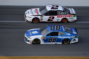 Alex Bowman, driver of the #88 Nationwide Chevrolet, races Brad Keselowski, driver of the #2 Discount Tire Ford, during the Monster Energy NASCAR Cup Series 60th Annual Daytona 500 at Daytona International Speedway on February 18, 2018 in Daytona Beach, Florida.