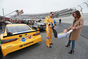 Kyle Busch, driver of the #18 Pedigree Toyota, and his wife, Samantha, play with their son, Brexton, before the start of the Monster Energy NASCAR Cup Series AAA 400 Drive for Autism at Dover International Speedway on May 6, 2018 in Dover, Delaware.