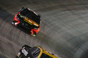 Clint Bowyer, driver of the #14 Rush Truck Centers/Cummins Ford, leads Martin Truex Jr., driver of the #78 Bass Pro Shops/Ducks Unlimited Toyota, during the Monster Energy NASCAR Cup Series Bass Pro Shops NRA Night Race at Bristol Motor Speedway on August 18, 2018 in Bristol, Tennessee.