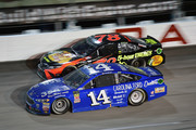 Clint Bowyer, driver of the #14 Carolina Ford Dealers Ford, leads Martin Truex Jr., driver of the #78 Bass Pro Shops/5-hour ENERGY Toyota, during the Monster Energy NASCAR Cup Series Bojangles' Southern 500 at Darlington Raceway on September 2, 2018 in Darlington, South Carolina.