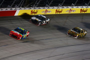 William Byron, driver of the #24 AXALTA Throwback Chevrolet, Ryan Newman, driver of the #31 Caterpillar Chevrolet, and Jamie McMurray, driver of the #1 McDonald's 50 Years of Big Mac Chevrolet, race during the Monster Energy NASCAR Cup Series Bojangles' Southern 500 at Darlington Raceway on September 2, 2018 in Darlington, South Carolina.