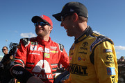 Dale Earnhardt Jr., driver of the #88 AXALTA Chevrolet, and Matt Kenseth, driver of the #20 DeWalt Hurricane Relief Toyota, take part in pre-race ceremonies for the Monster Energy NASCAR Cup Series Championship Ford EcoBoost 400 at Homestead-Miami Speedway on November 19, 2017 in Homestead, Florida.