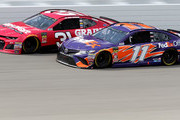 Ryan Newman, driver of the #31 Grainger Chevrolet, leads Denny Hamlin, driver of the #11 FedEx Office Toyota, during the Monster Energy NASCAR Cup Series Consmers Energy 400 at Michigan International Speedway on August 12, 2018 in Brooklyn, Michigan.