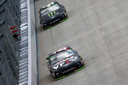 Clint Bowyer, driver of the #14 Haas VF1/Rush Truck Centers Ford, leads Kurt Busch, driver of the #41 Monster Energy/Haas Automation Ford, during the Monster Energy NASCAR Cup Series Gander Outdoors 400 at Dover International Speedway on October 7, 2018 in Dover, Delaware.