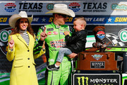 Kyle Busch, driver of the #18 Interstate Batteries Toyota, poses in Victory Lane with his son Brexton and wife Samantha after winning the Monster Energy NASCAR Cup Series O'Reilly Auto Parts 500 at Texas Motor Speedway on April 8, 2018 in Fort Worth, Texas.