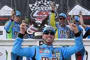 Kyle Busch, driver of the #18 M&M's Hazelnut Toyota, celebrates in Victory Lane after winning the Monster Energy NASCAR Cup Series Pocono 400 at Pocono Raceway on June 02, 2019 in Long Pond, Pennsylvania.