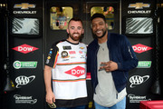 American actor Jocko Sims meets with Austin Dillon, driver of the #3 Dow Chevrolet, in the garage area prior to the Monster Energy NASCAR Cup Series Pocono 400 at Pocono Raceway on June 02, 2019 in Long Pond, Pennsylvania. Sims will wave the green flag to start the Pocono 400.