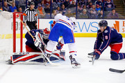 Zach Werenski #8 of the Columbus Blue Jackets attempts to control the puck as Brendan Gallagher #11 of the Montreal Canadiens fires the puck wide of Sergei Bobrovsky #72 of the Columbus Blue Jackets during the first period on March 12, 2018 at Nationwide Arena in Columbus, Ohio.