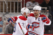 Max Pacioretty #67 of the Montreal Canadiens celebrates with Andrei Markov #79 after Pacioretty scored a power play goal against the Arizona Coyotes during the third period of the NHL game at Gila River Arena on February 9, 2017 in Glendale, Arizona. The Canadiens defeated the Coyotes 5-4 in overtime.