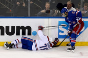 Andrei Markov #79 of the Montreal Canadiens falls to the ice after a play against Derek Stepan #21 of the New York Rangers during Game Six of the Eastern Conference Final in the 2014 NHL Stanley Cup Playoffs at Madison Square Garden on May 29, 2014 in New York City.