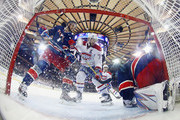 Kevin Hayes #13 and Henrik Lundqvist #30 of the New York Rangers defend against Andrei Markov #79 of the Montreal Canadiens at Madison Square Garden on February 21, 2017 in New York City. The Canadiens defeated the Rangers 3-2 in the shootout.