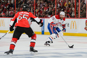 Andrei Markov #79 of the Montreal Canadiens moves the puck past Erik Karlsson #65 of the Ottawa Senators in Game Six of the Eastern Conference Quarterfinals during the 2015 NHL Stanley Cup Playoffs at Canadian Tire Centre on April 26, 2015 in Ottawa, Ontario, Canada.