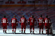 (L-R) Antoine Vermette #50, Mikkel Boedker #89, Lauri Korpikoski #28, Zbynek Michalek #4, Oliver Ekman-Larsson #23 and goaltender Mike Smith #41 of the Phoenix Coyotes stand attended for the National Anthem before the NHL game against the Montreal Canadiens at Jobing.com Arena on March 6, 2014 in Glendale, Arizona. The Coyotes defeated the Canadiens 5-2.