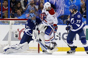 Ben Bishop #30 of the Tampa Bay Lightning makes a save as Andrei Markov #79 of the Montreal Canadiens crashes the net past the defense of Victor Hedman #77 in Game Three of the Eastern Conference Semifinals during the 2015 NHL Stanley Cup Playoffs at Amalie Arena on May 6, 2015 in Tampa, Florida.