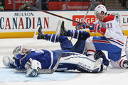 Brendan Gallagher #11 of the Montreal Canadiens slams into Curtis McElhinney #35 of the Toronto Maple Leafs during an NHL game at the Air Canada Centre on March 17, 2018 in Toronto, Ontario, Canada. The Maple Leafs defeated the Canadiens 4-0.