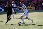 Sean Franklin #5 of D.C. United and Dilly Duka #11 of Montreal Impact go after the ball during the first half at RFK Stadium on March 7, 2015 in Washington, DC.