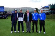 (L-R) Webb Simpson and Bubba Watson of the United States, referee John Paramor, Henrik Stenson and Justin Rose of Europe pose on the 1st tee prior to the Morning Fourballs of the 2014 Ryder Cup on the PGA Centenary course at the Gleneagles Hotel on September 26, 2014 in Auchterarder, Scotland.