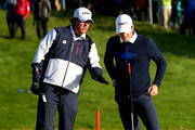 Phil Mickelson (L) and Keegan Bradley of the United States talk on the 2nd green during the Morning Fourballs of the 2014 Ryder Cup on the PGA Centenary course at the Gleneagles Hotel on September 26, 2014 in Auchterarder, Scotland.