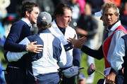 Keegan Bradley and Phil Mickelson of the United States celebrate victory with United States team captain Tom Watson after the Morning Fourballs of the 2014 Ryder Cup on the PGA Centenary course at the Gleneagles Hotel on September 26, 2014 in Auchterarder, Scotland.