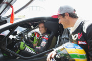 "Johann Zarco of France and Monster Yamaha Tech 3 and Bruno Senna . of Brasile (R) pose during the pre-event ""A race between a Yamaha M1 and a McLaren GT3"" during the MotoGP Netherlands - Preview on June 22, 2017 in Assen, Netherlands."