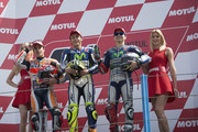 (L-R) Marc Marquez of Spain and Repsol Honda Team, Valentino Rossi of Italy and Movistar Yamaha MotoGP and Jorge Lorenzo of Spain and Movistar Yamaha MotoGP pose on the podium at the end of the MotoGP race during the MotoGP Netherlands - Race at  on June 27, 2015 in Assen, Netherlands.