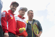 (L-R) Andrea Dovizioso of Italy and Ducati Team, Jack Miller of Australia and Alma Pramac Racing and Lleyton Hewitt of Australia (Australian Davis Cup captain) pose during the MotoGP of Australia - Previews during a media call ahead of the 2018 MotoGP of Australia at  on October 24, 2018 in Melbourne, Australia.