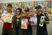 "(L-R) Valentino Rossi of Italy and Ducati Marlboro Team, Japanese manga artist Ranka,  Dani Pedrosa of Spain and Repsol Honda Team and Cal Crutchlow of Great Britain and Monster Yamaha Tech 3 MotoGP Of Japan pose during the pre-event ""MotoGP riders meet the manga artist Ranka"" at Twin Ring Hotel during the MotoGP Of Japan at Twin Ring Motegi on October 11, 2012 in Motegi, Japan."