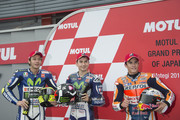 (L-R) Valentino Rossi of Italy and Movistar Yamaha MotoGP, Jorge Lorenzo of Spain and Movistar Yamaha MotoGP and  Marc Marquez of Spain and Repsol Honda Team pose at the end of the qualifying practice during the MotoGP Of  Japan - Qualifying at Twin Ring Motegi on October 10, 2015 in Motegi, Japan.