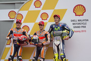 (L-R) Marc Marquez of Spain and Repsol Honda Team, Dani Pedrosa of Spain and Repsol Honda Team and Valentino Rossi of Italy and Movistar Yamaha MotoGP pose at the end of the qualifying practice during the MotoGP Of Malaysia at Sepang Circuit on October 24, 2015 in Kuala Lumpur, Malaysia.