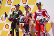 (L-R) Johann Zarco of France and Monster Yamaha Tech 3, Dani Pedrosa of Spain and Repsol Honda Team and Andrea Dovizioso of Italy and Ducati Team pose   at the end of the MotoGP qualifying practice during the MotoGP Of Malaysia - Qualifying at Sepang Circuit on October 28, 2017 in Kuala Lumpur, Malaysia.