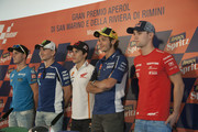 (L-R) Pol Espargaro of Spain and Pons 40 HP Tuenti, Jorge Lorenzo of Spain and Yamaha Factory Racing, Marc Marquez of Spain and Repsol Honda Team, Valentino Rossi of Italy and Yamaha Factory Racing and Jonas Folger of Germany and Kalex KTM Team Aspar  pose after the qualifying practice during the MotoGP of San Marino - Qualifying at Misano World Circuit on September 14, 2013 in Misano Adriatico, Italy.