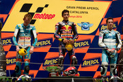 L-R Bradley Smith of Great Britain and Bancaja Aspar Team, Marc Marquez of Spain and Red Bull AJo Motorsport and Pol Espargaro of Spain and Tuenti Racing pose on the podium at the end of 125 cc race of MotoGP of Catalunya in Catalunya circuit on July 4, 2010 in Montmelo, Spain.